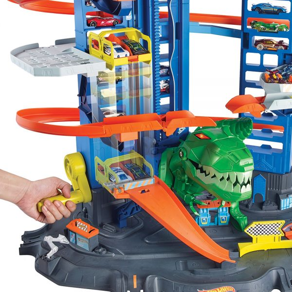 Hot Wheels - Ultimate Garage, Assalto del T-Rex Robot, con 2 Macchinine incluse, può Contenere più di 100 Macchinine    Hot Wheels