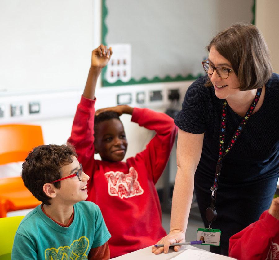 School teacher with children