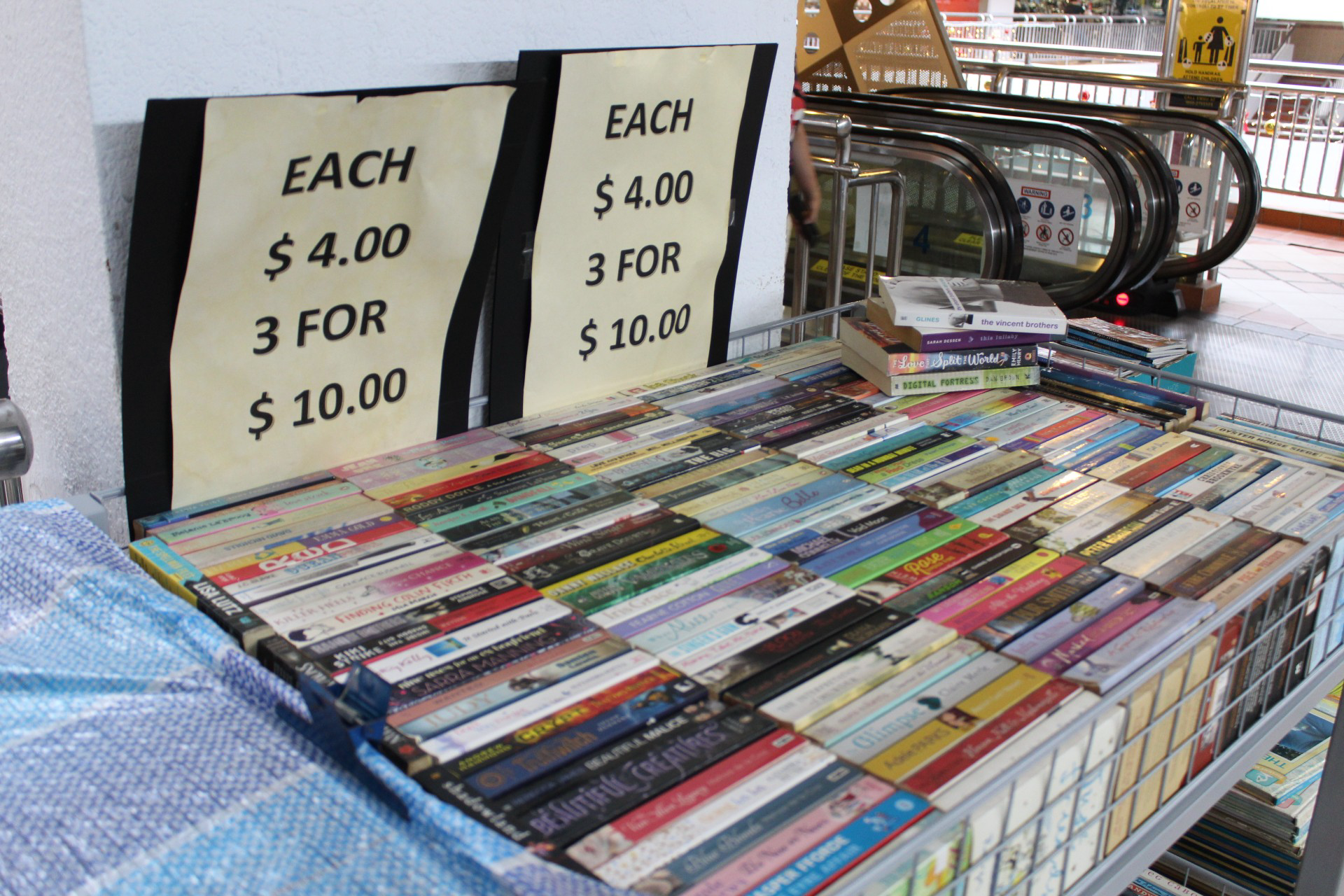 Discounts on books - 1 for $4, 3 for $10