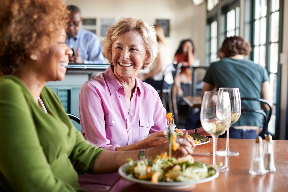 middle age women have lunch during a conversation