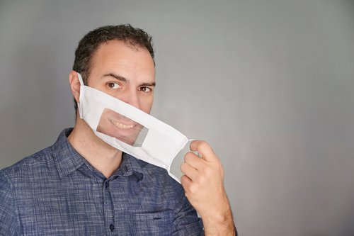 man wearing clear mask