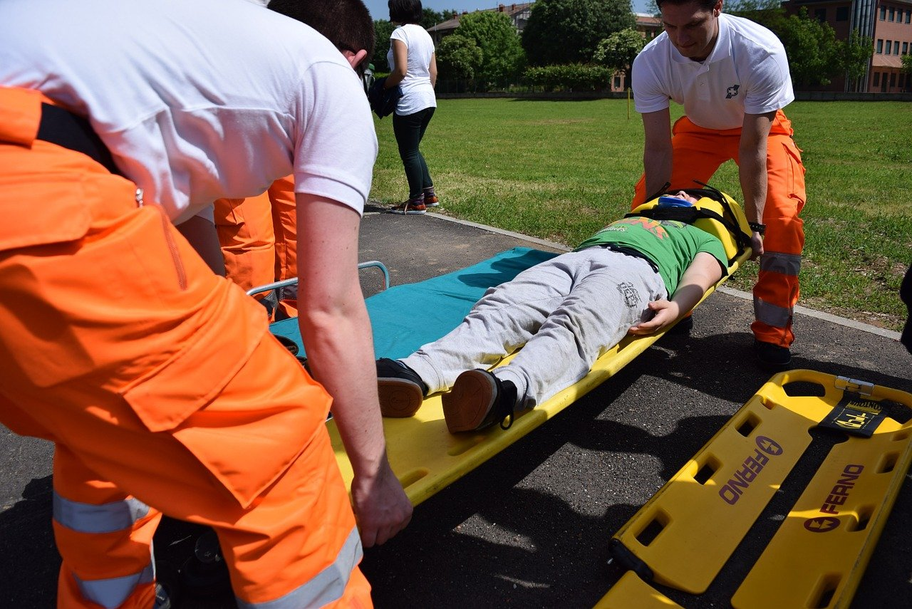 a man is transported by paramedics after a work accident