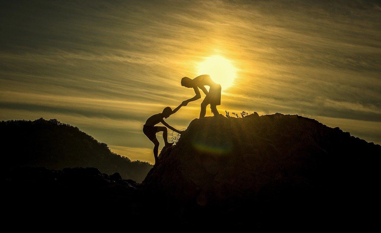 two people climbing mountain