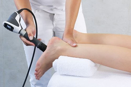 Physio-therapist doing Extra-corporeal pulsed-activated therapy