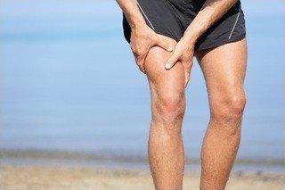 Man holding his thigh