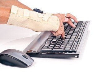 Person typing with wrist brace