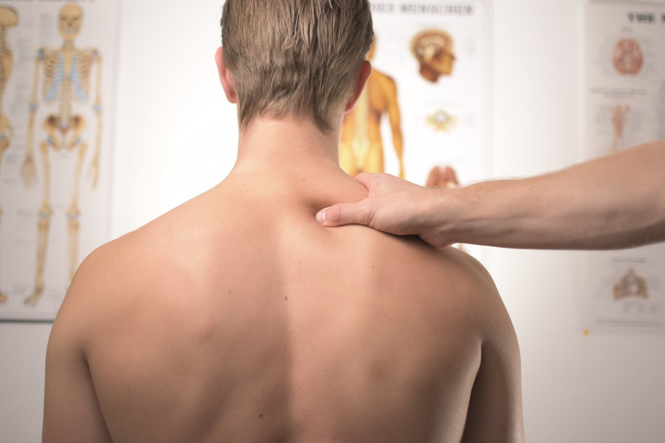 A man sees a doctor for back or neck pain