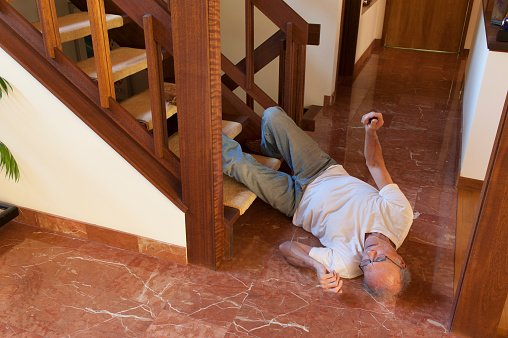 Old man fell down from the steps