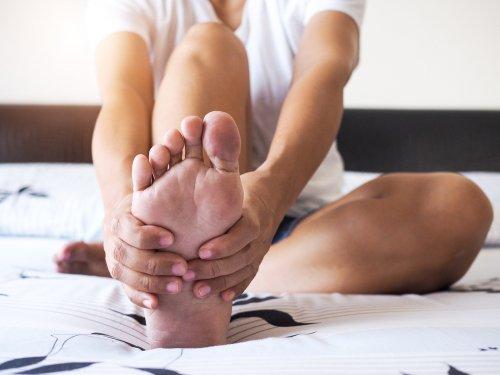 woman massaging foot
