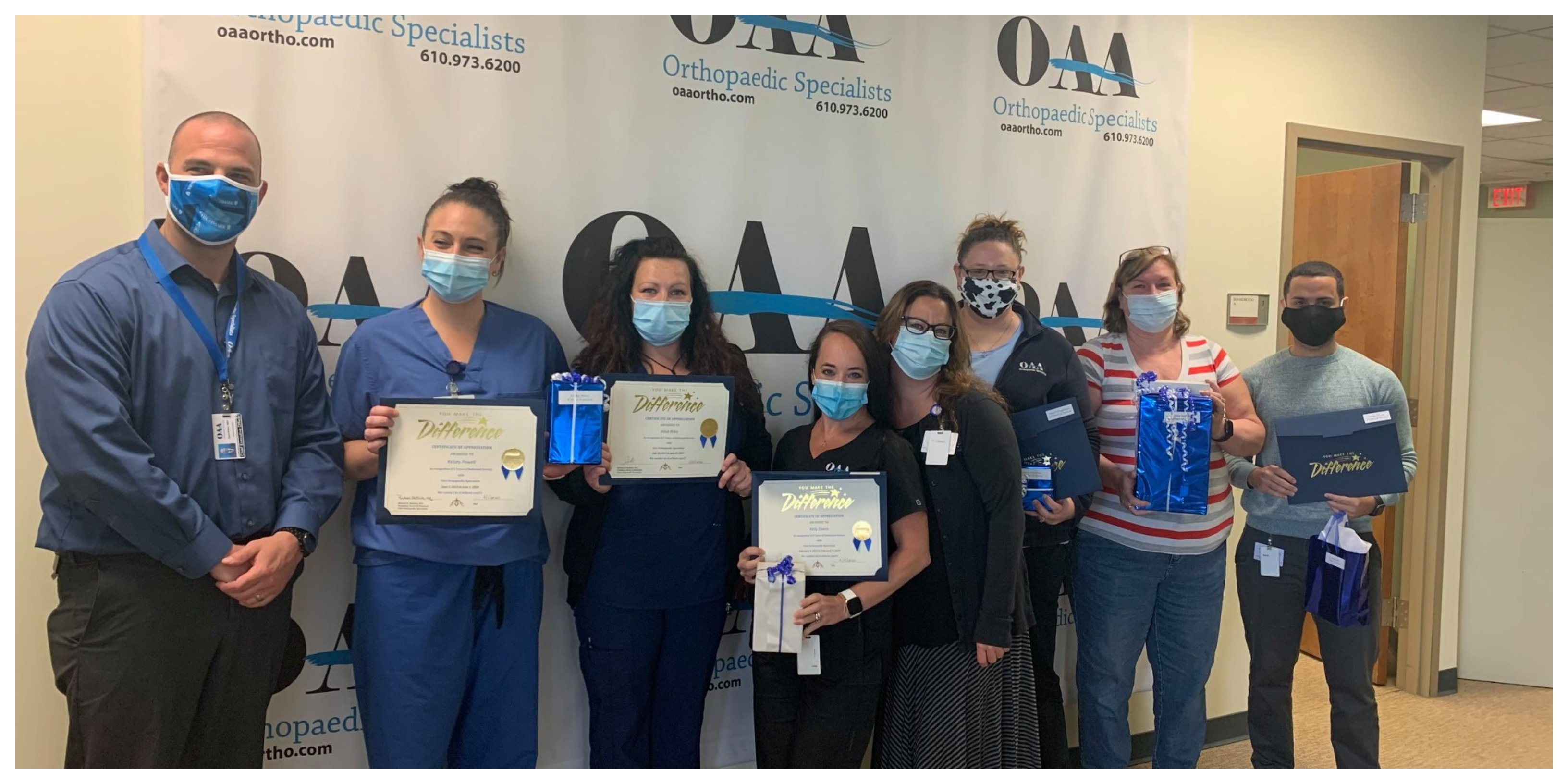 People in Masks Holding Difference Certificates