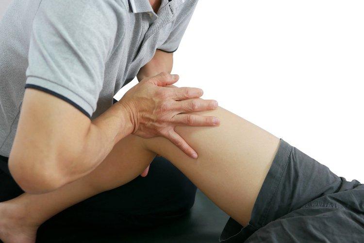 Man Holding Another Man's Leg