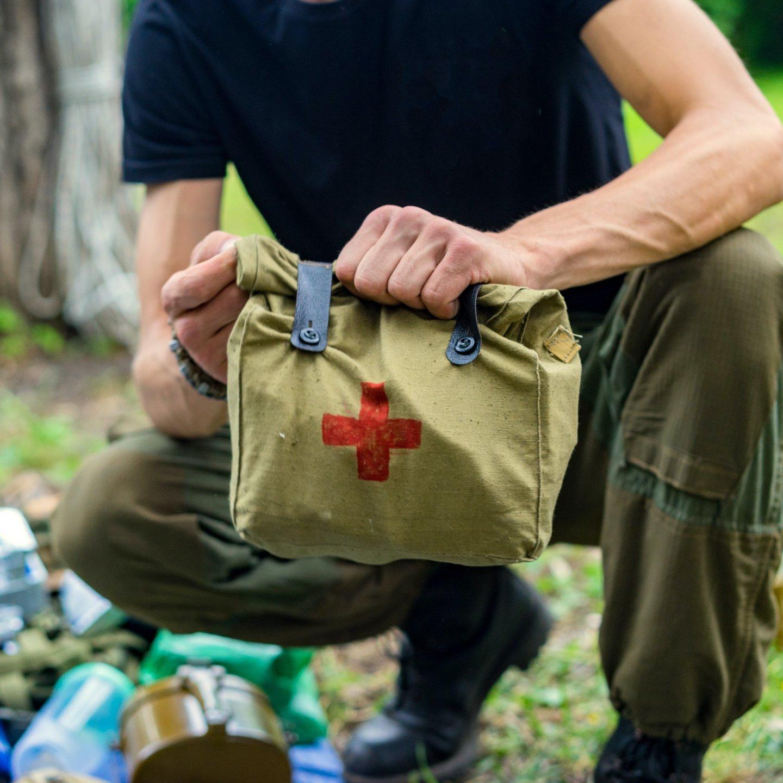 Man Holding a Medical Kit