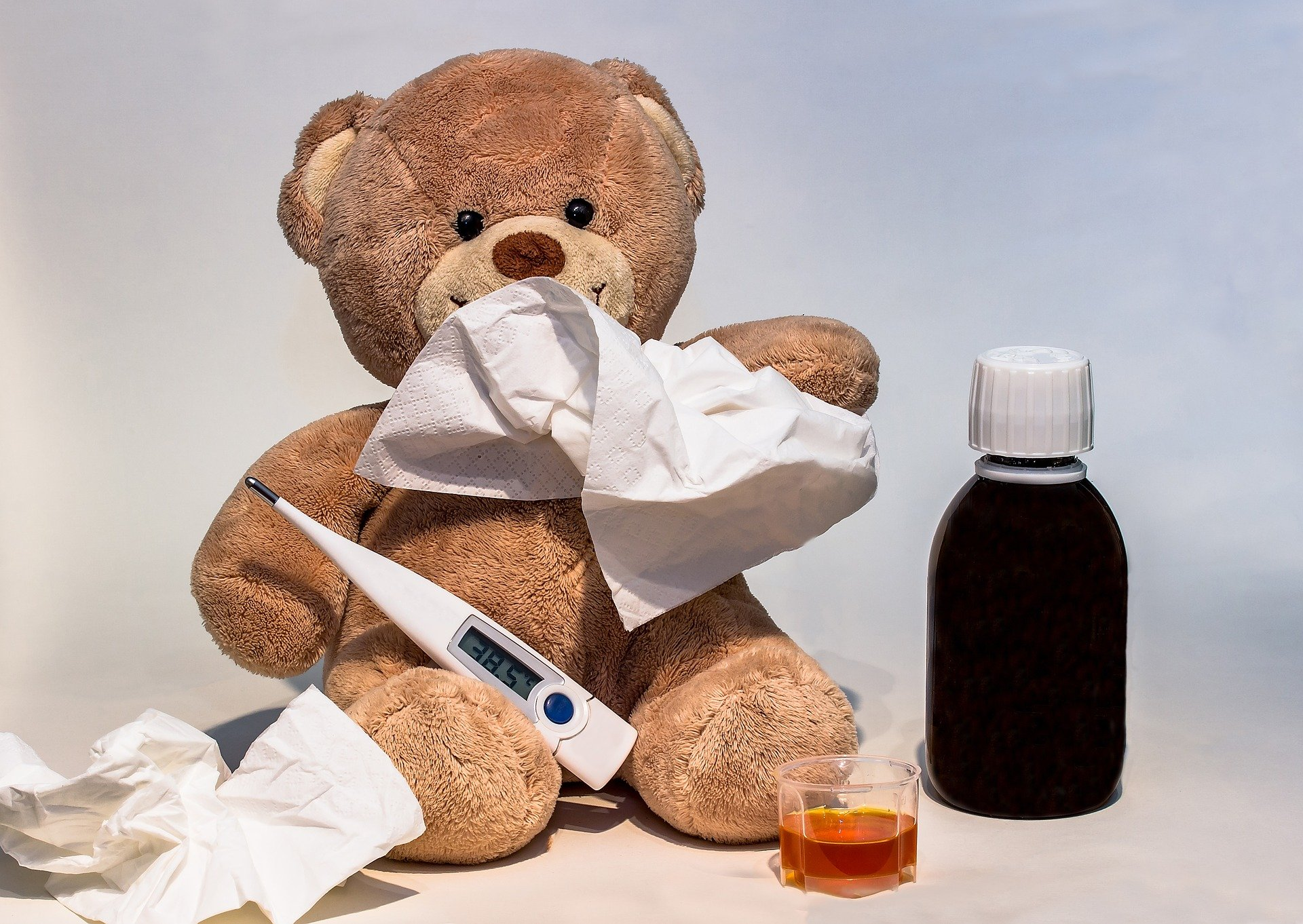 a teddy bear with flu medicine