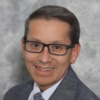 Charles Delacuadra, headshot