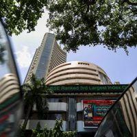 Stock Market Live Updates: Sensex, Nifty trade flat amid volatility; mid, smallcaps outperform