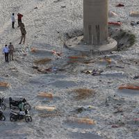 Indian police find bodies on riverbank amid raging COVID19