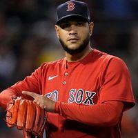 Red Sox pitcher Eduardo Rodriguez mimics Carlos Correa's watch gesture, drawing rebuke from Boston manager Alex Cora
