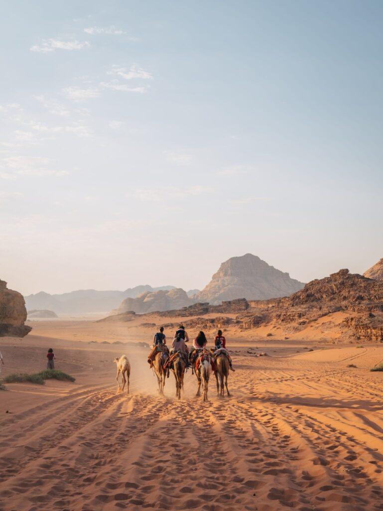 Camels riding in the Wadi Rum desert in Jordan