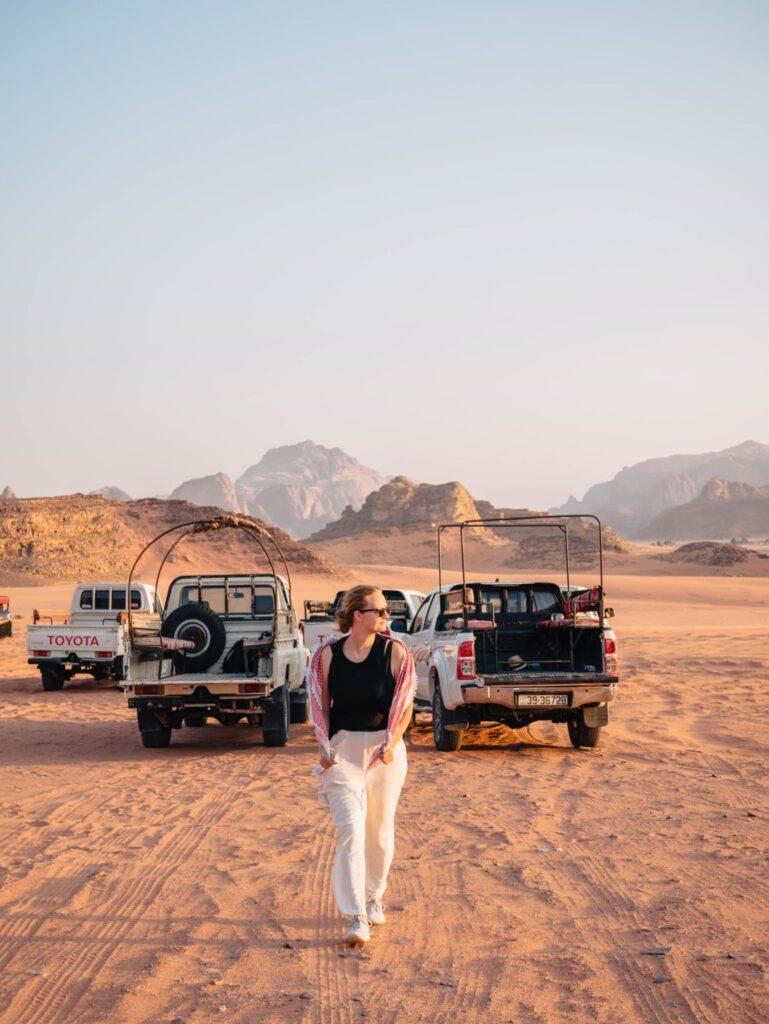 Alexandra Hayward (@findingalexx) posing by the safari at Wadi Rum, Jordan