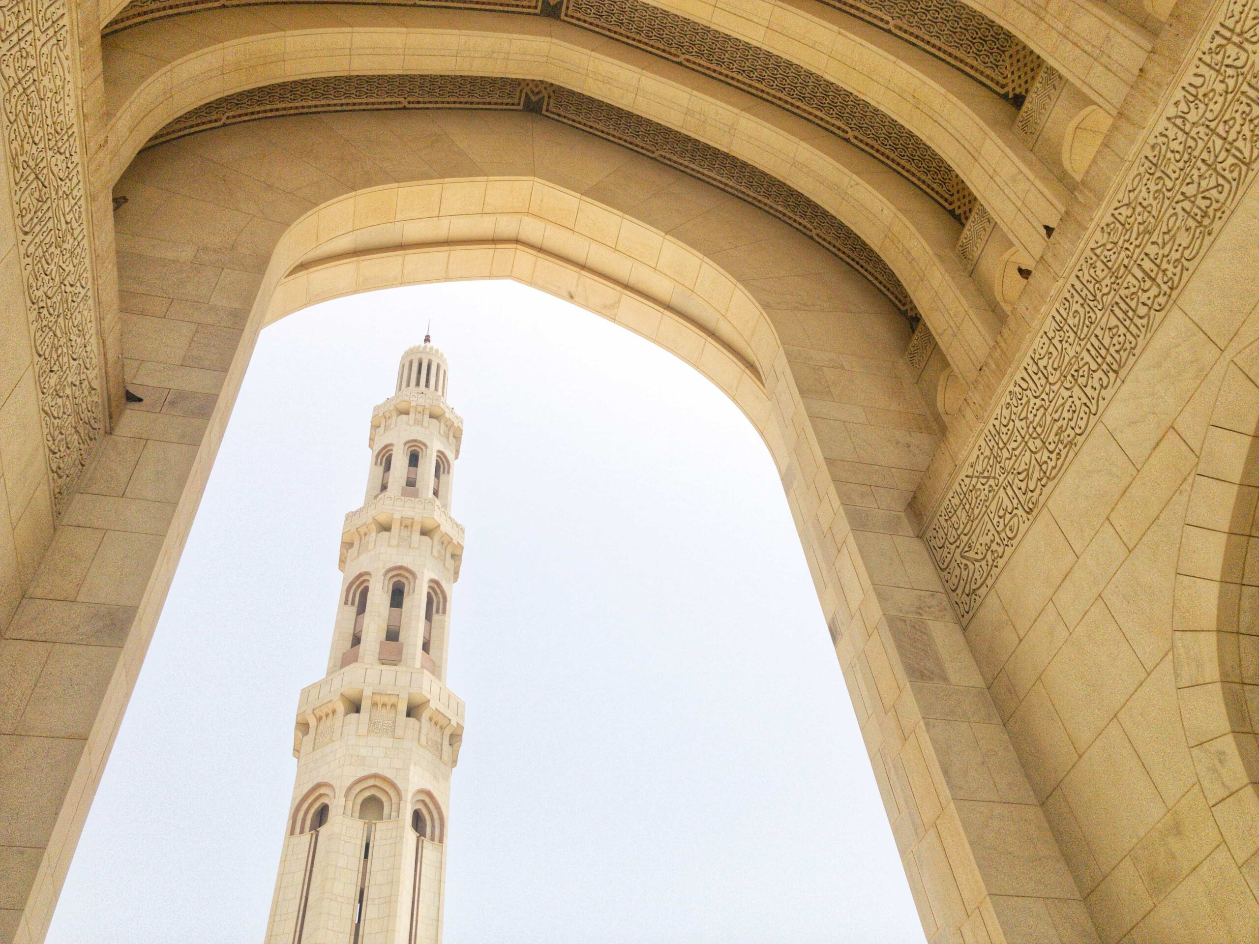 An Interior view of the Sultan Qaboos with a minaret seen across