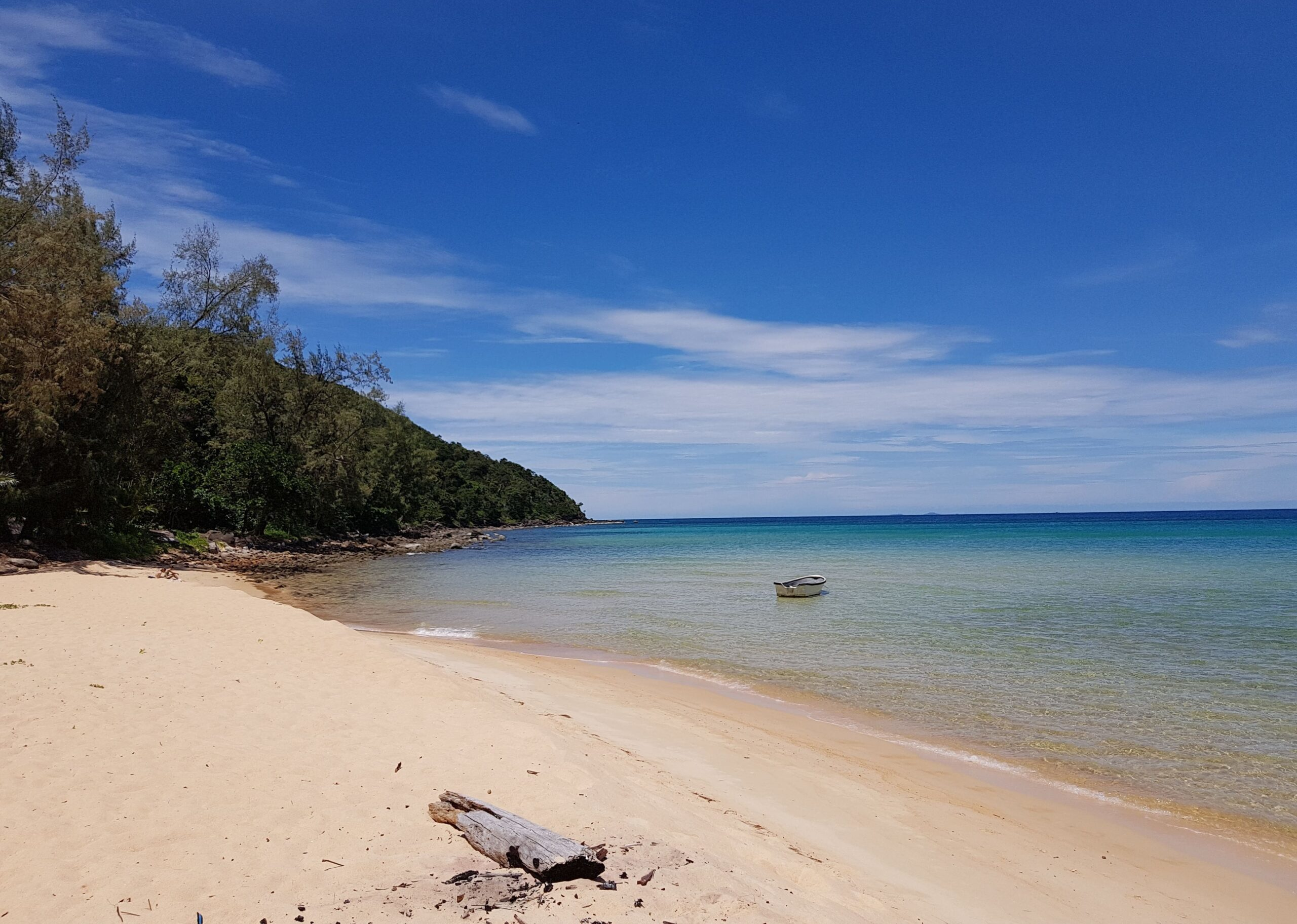 The beach at Koh Rong Samloem with a boat in the water