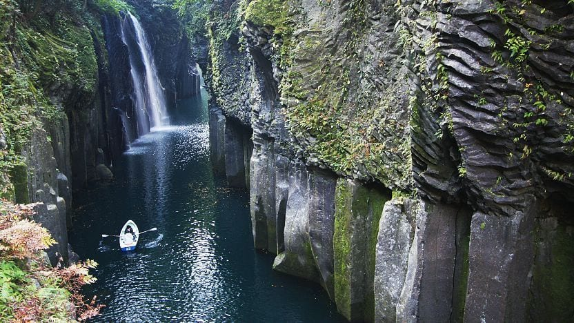 Takachiho Gorge in Japan - A person kayaking by the lake