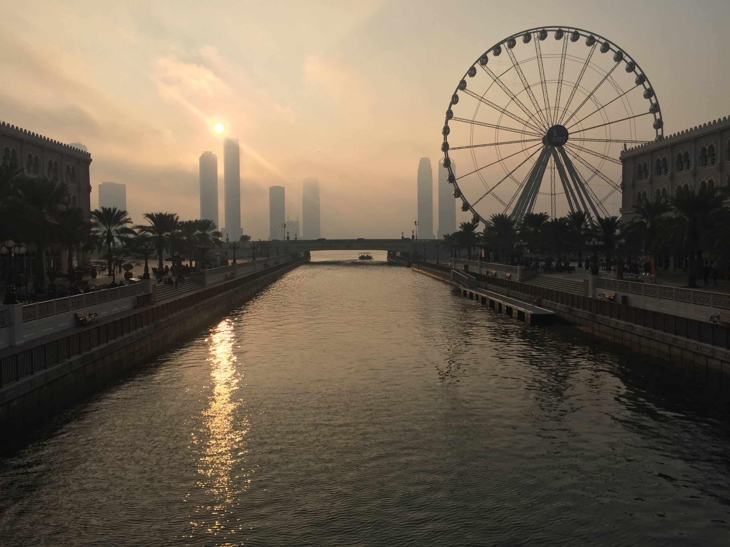 Qasba and Giant Wheel over sunset in Sharjah