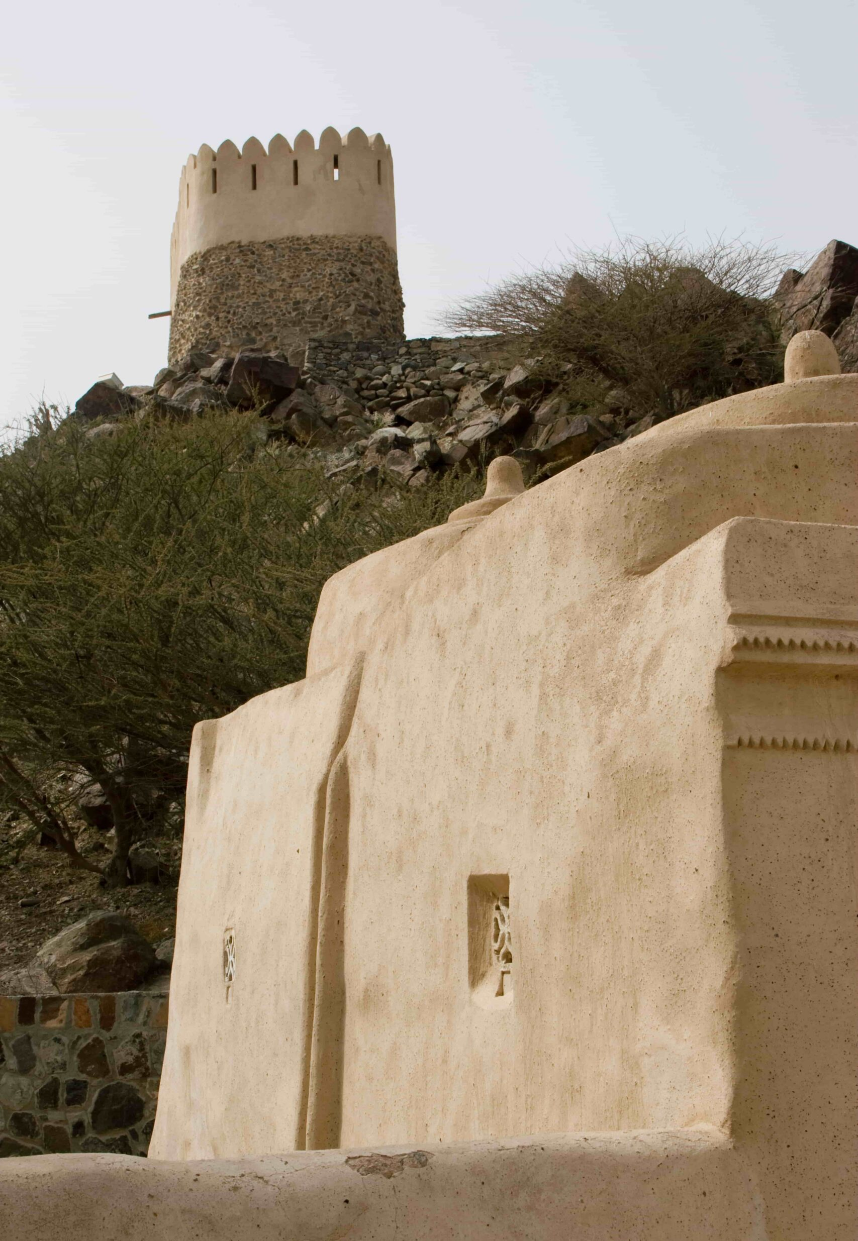 Al Bidyah Mosque over looking a fort in Fujairah