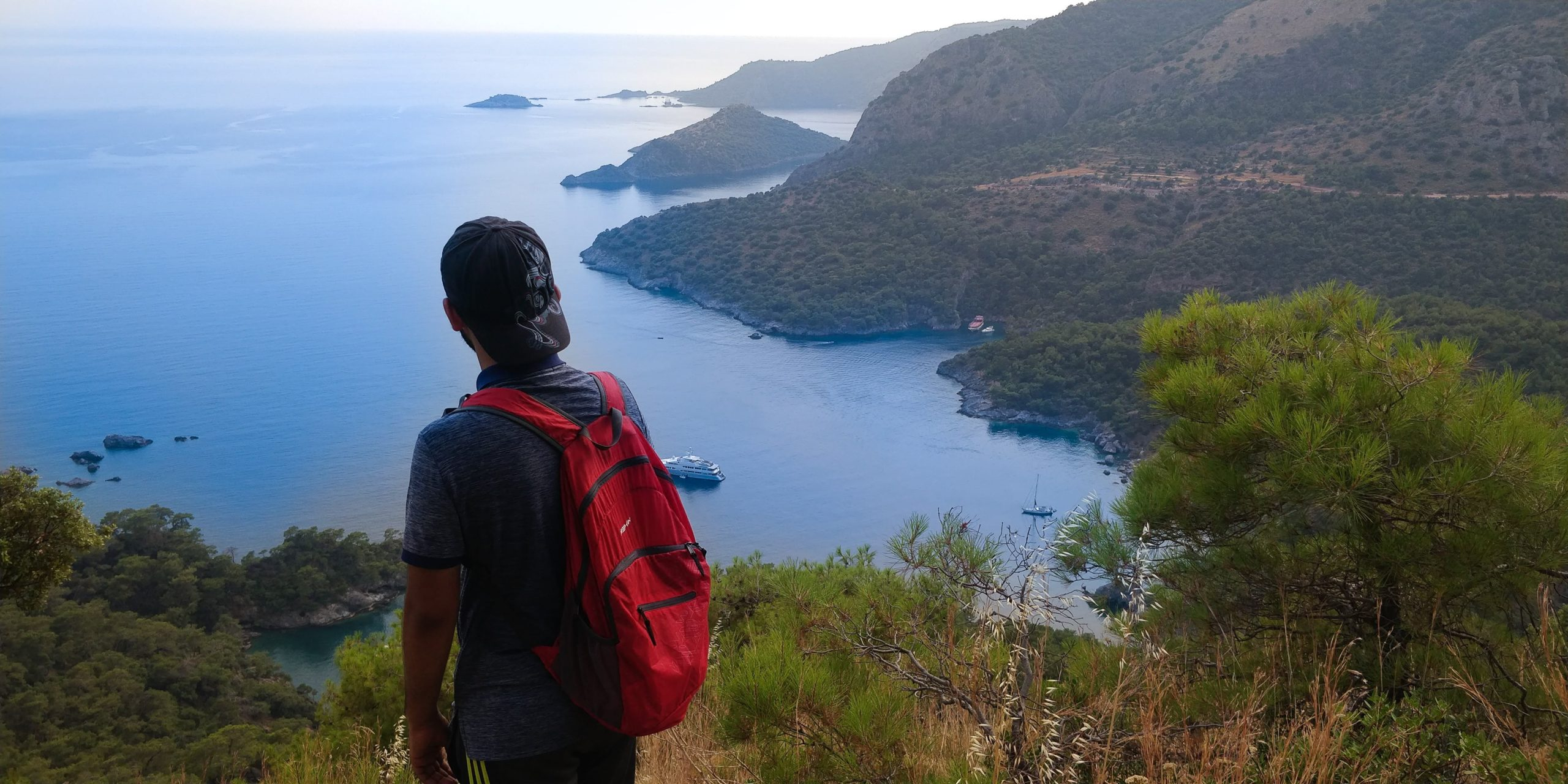 Man looking over hiking trail in Fethiye in Turkey