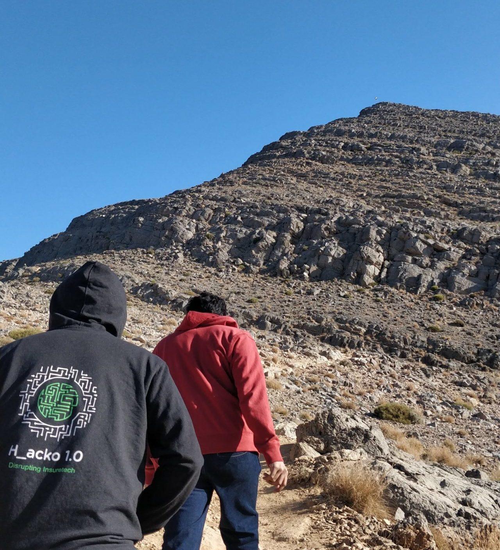 2 boys hiking on the Jebal Jais trail on a sunny day