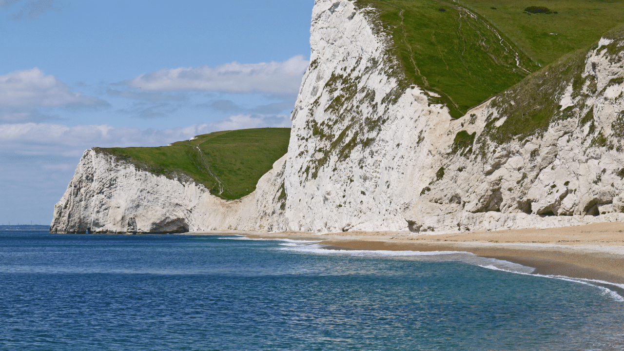 'White cliffs and blue sea along UK's Jurassic coast.'