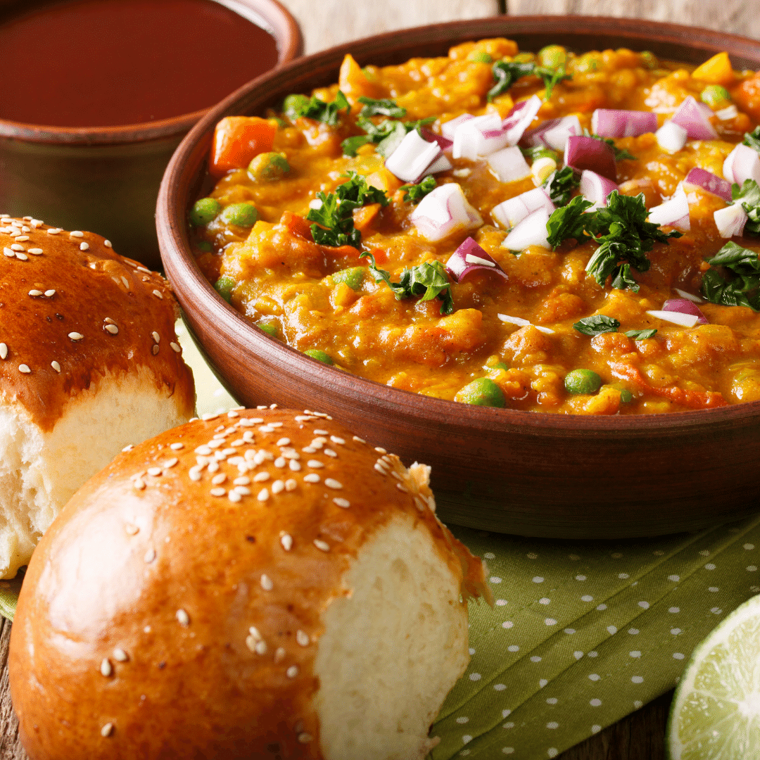 Pav Bread on the surface and bhaji on a bowl