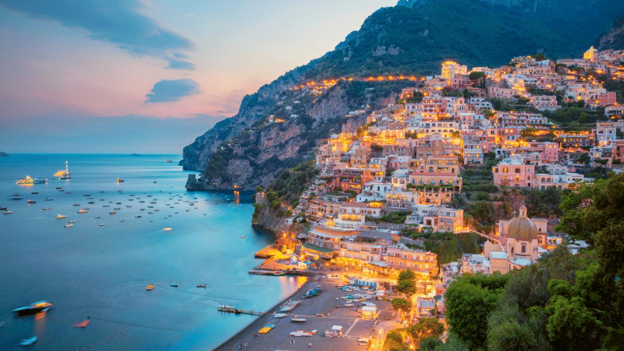Aerial image of famous city Positano located on Amalfi Coast, Italy during sunset.