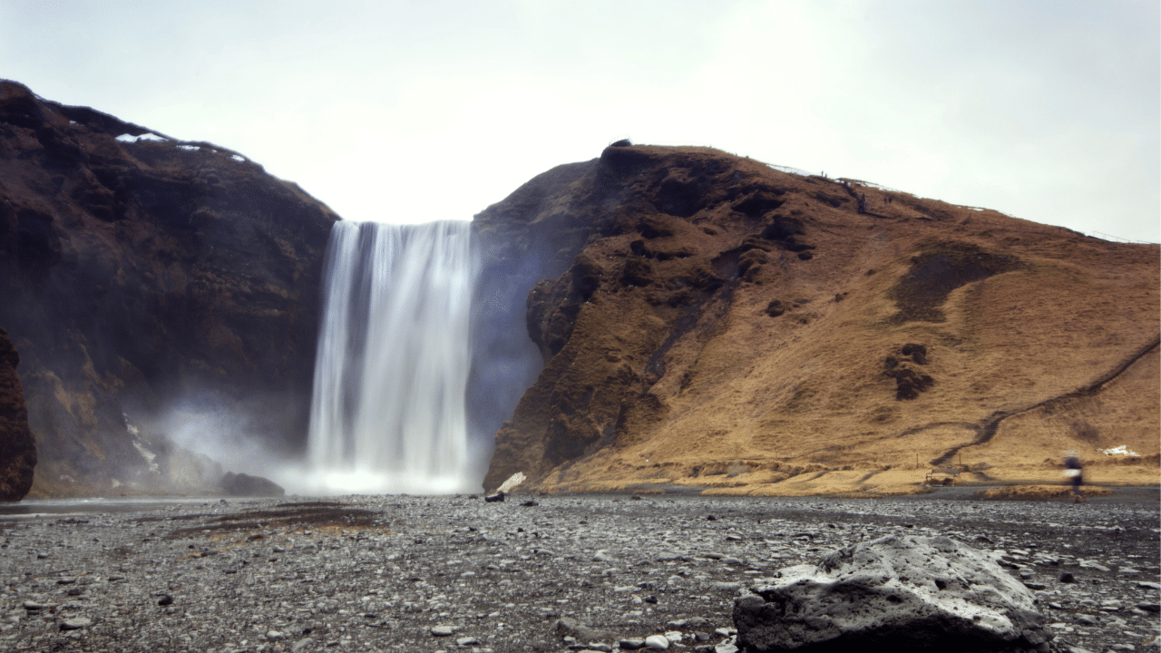 April 2015 - The majestic Skogafoss waterfall in Iceland cascades powerfully over the cliff edge sending a diffused spray of water out onto the surrounding landscape.