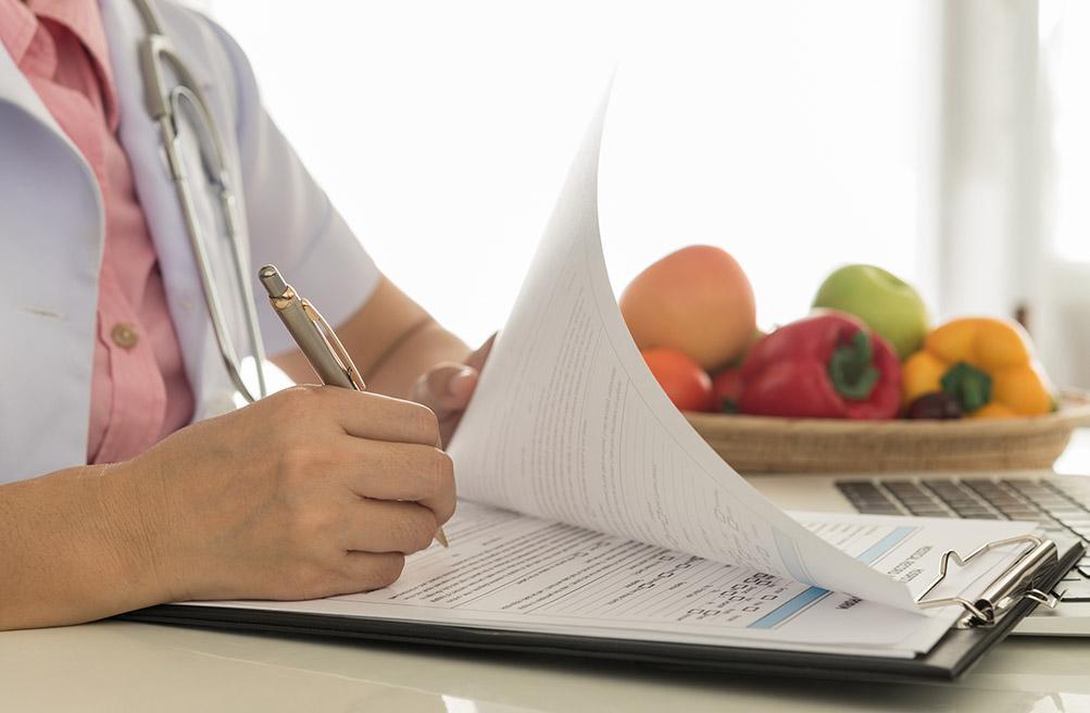 A Trillium Woods health and wellness navigator fills out paperwork