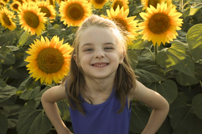 Super Kaylee in front of sunflowers