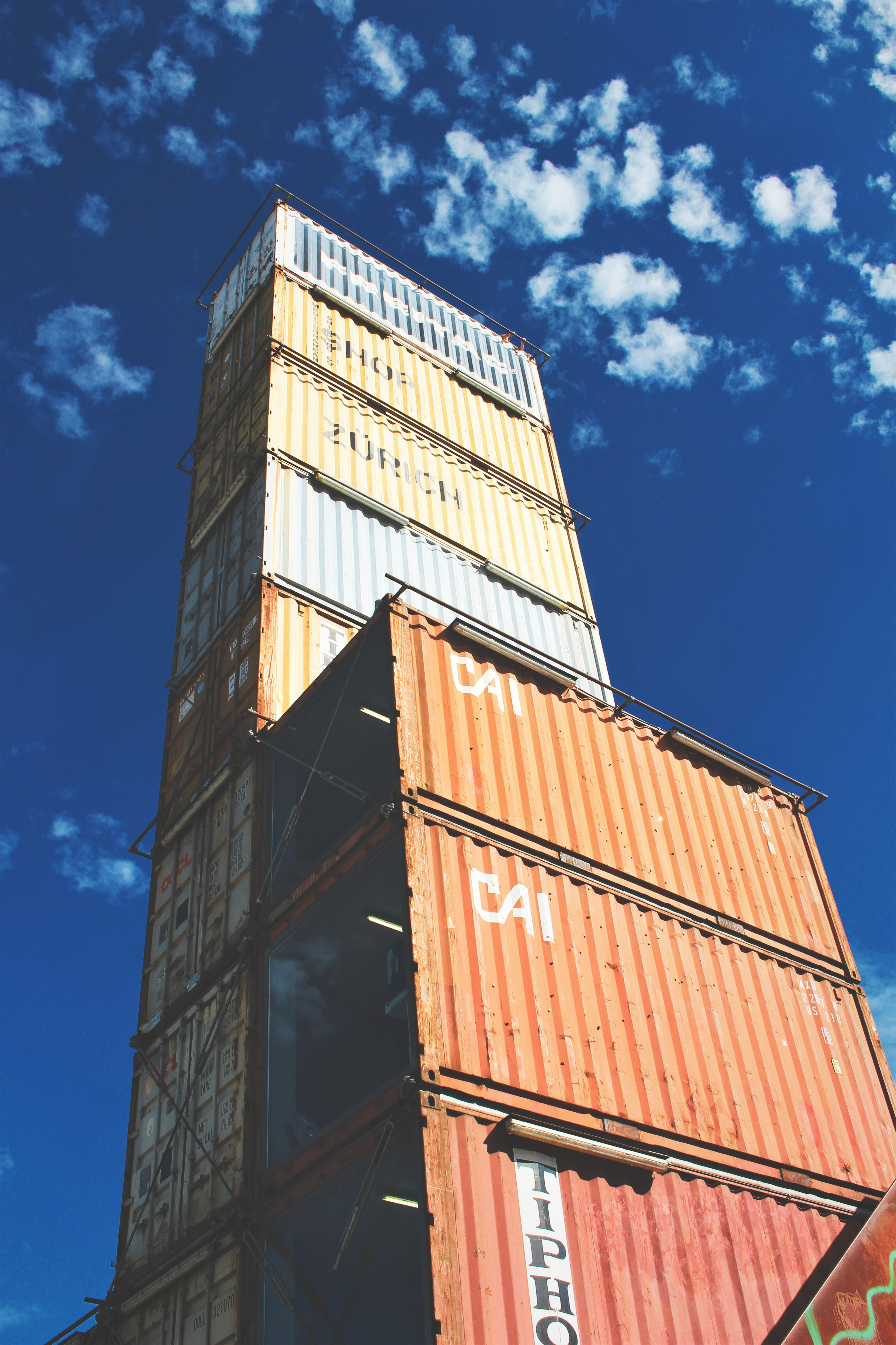 Multi-colored stacked shipping containers that make the Freitag Tower in Zurich