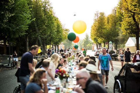 Street fest in Copenhagen with long tables full of people and food