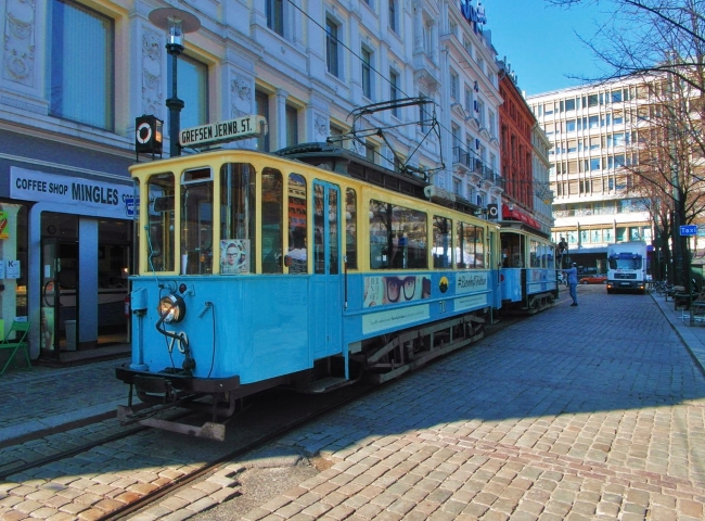 Blue and yellow Old City Tram on historic Oslo street