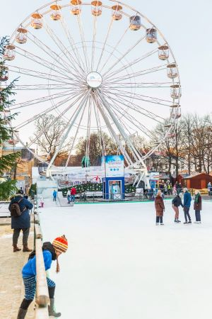 Wintry Oslo Christmas Market with ferris wheel in background