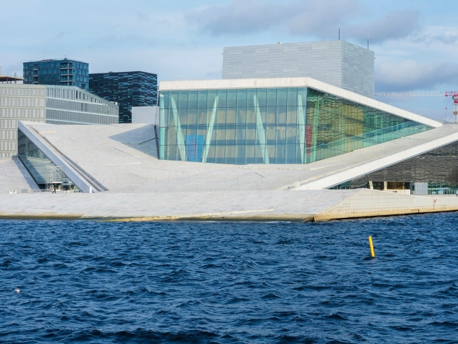 View of Oslo Opera with deep blue water in foreground