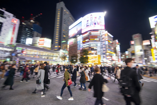 Busy Shibuya city at night with people crossing the street