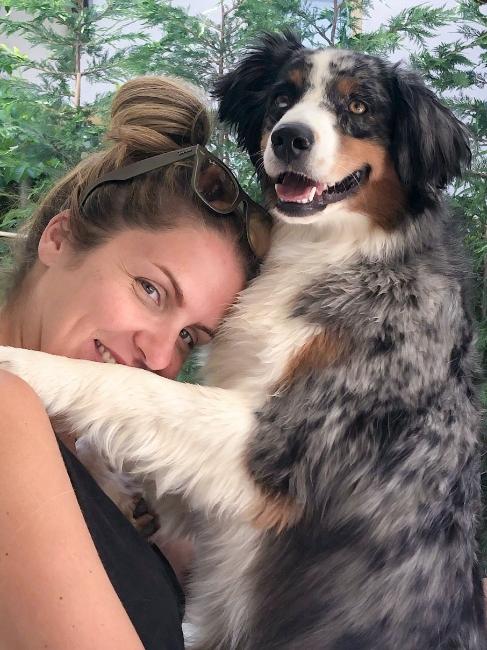 Juliana hugging her dog Merlot!