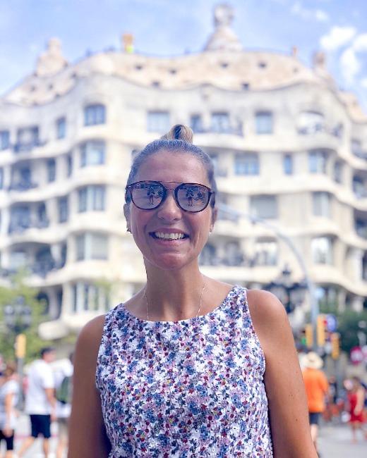 Juliana in sunglasses in front of Gaudi's La Pedrera in Barcelona