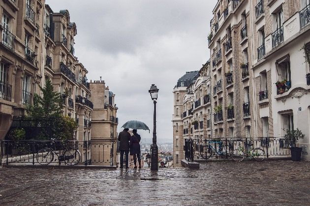 Romantic Couple under umbrella in Montmartre, Paris, France