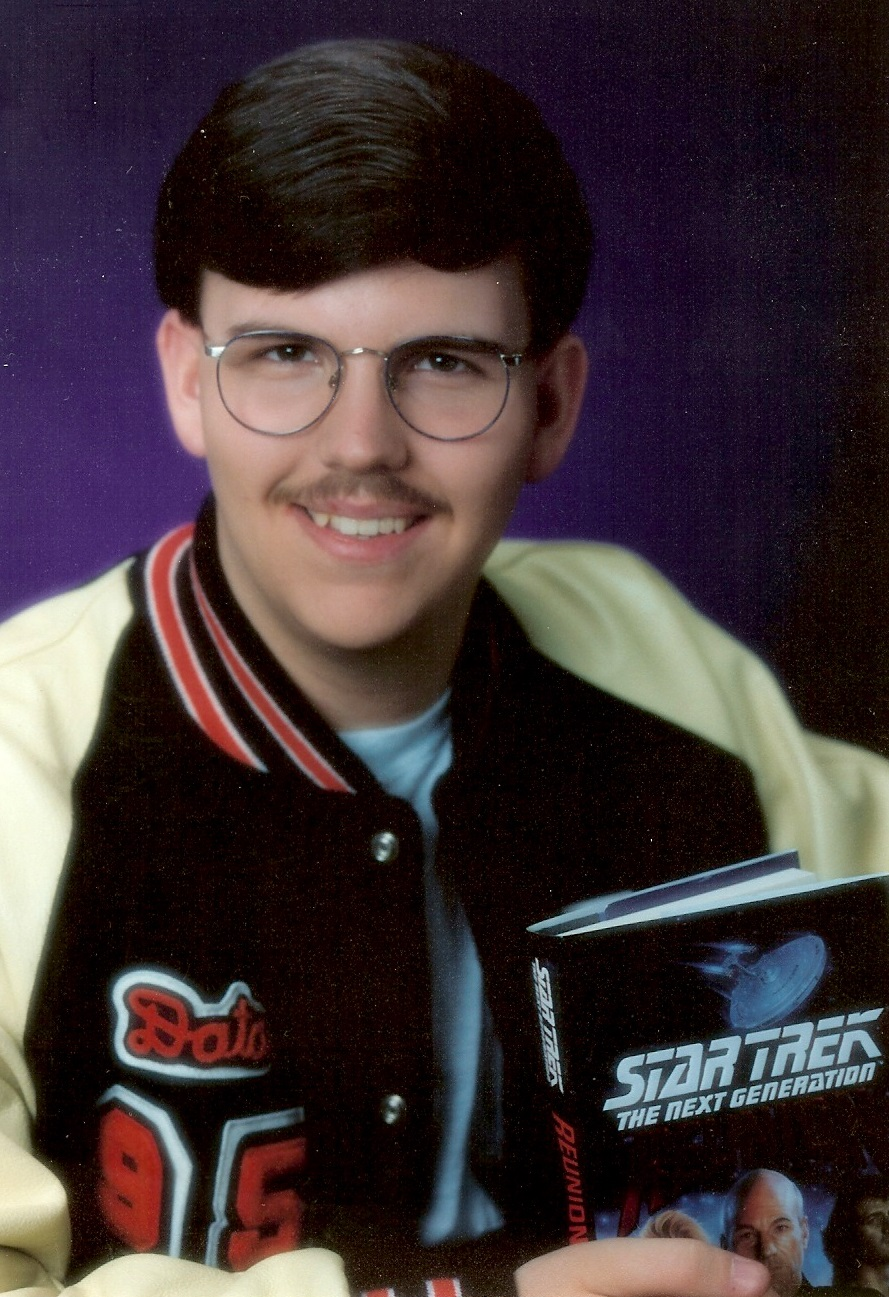 Data Logan picture from senior year in high school. Dirty 'stache all out there Data name on letterman's jacket (for academics) Star Trek book in hand