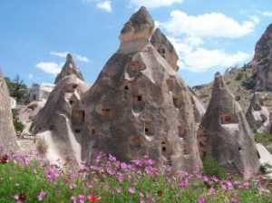 Fairy cimneys in Cappadocia, with dwellings carved into the rock bodies of these natural wonders