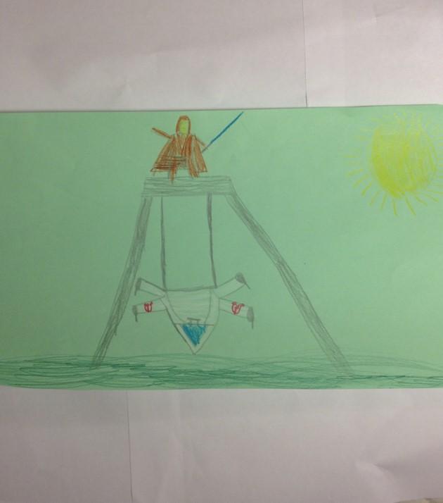 Hankkeen työpajassa tuotettu lapsen piirros Star Wars -keinusta, johon pääsee myös pyörätuolilla. Kuva: Kaisa Voutilainen.