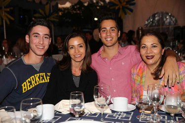 Photo of a Cal family sitting at a table