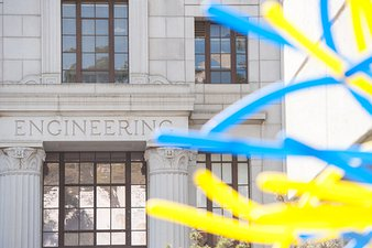 image of engineering building facade with blue and gold balloons in foreground